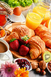 Breakfast consisting of croissants, coffee, fruits, orange juice Royalty Free Stock Photography