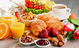 Breakfast consisting of croissants, coffee, fruits, orange juice Royalty Free Stock Images