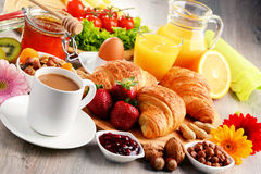 Breakfast consisting of croissants, coffee, fruits, orange juice Stock Photography