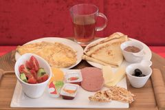 Breakfast consisting of omelet, pancakes, vegetables, sausage, c royalty free stock photos