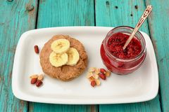 Breakfast of cookie with peanut butter, banana and raspberry jam Royalty Free Stock Photo