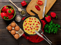 Breakfast. Cooking of an omelette with sweet red bolgarian peppe Stock Images