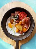 Breakfast in cooking pan with fried eggs, sausages, bacon Royalty Free Stock Photography
