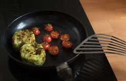 Breakfast cooking with tomato and Potato on pan royalty free stock photography