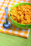 Breakfast corn flakes in green bowl Royalty Free Stock Images