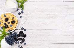 Breakfast with corn flakes, milk and berry . Stock Image
