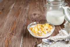 Breakfast with corn flakes and milk in rural style Royalty Free Stock Photo
