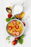 Breakfast with corn flakes, milk  and strawberry Royalty Free Stock Photo