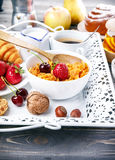 Breakfast with cornflakes berry honey and croissant. On wooden board white tray Stock Image