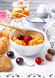 Breakfast with cornflakes berry honey light croissant. On wooden board white tray Royalty Free Stock Image