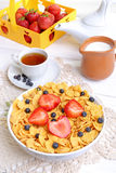 Breakfast - cornflakes with  strawberries and blueberries Stock Images
