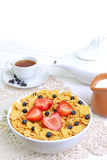 Breakfast - cornflakes with  strawberries and blueberries Royalty Free Stock Photos