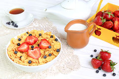 Breakfast - cornflakes with  strawberries and blueberries Stock Photos