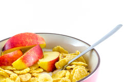 Breakfast with cornflakes on the white background. Royalty Free Stock Photos