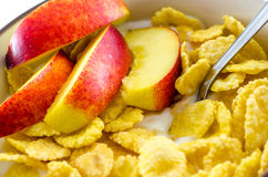 Breakfast with cornflakes on the white background. Royalty Free Stock Photo