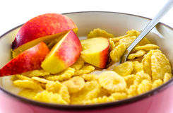 Breakfast with cornflakes on the white background. Stock Images