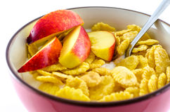 Breakfast with cornflakes on the white background. Royalty Free Stock Photography