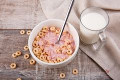 Breakfast, corn rings with yogurt, and milk on a wooden background stock photography