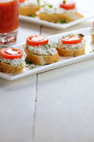 Breakfast of cottage cheese bruschettas and tomato juice Stock Images