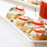 Breakfast of cottage cheese bruschettas and tomato juice Royalty Free Stock Photography