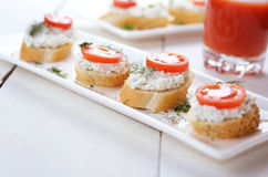 Breakfast of cottage cheese bruschettas and tomato juice Royalty Free Stock Images