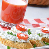 Breakfast of cottage cheese bruschettas and vegetable basket Stock Photos