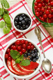 Breakfast. Cottage cheese with fruit, berries, flax seeds and Chia seeds. Red currant, peach, blueberry, mint Stock Photography