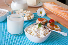 Breakfast with cottage cheese, glass of milk, bulgarian cheese Stock Photo