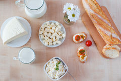 Breakfast with cottage cheese, glass of milk, bulgarian cheese a Stock Photos