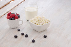 Breakfast with cottage cheese, milk and berries Royalty Free Stock Images