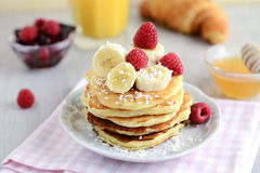 Breakfast cottage cheese pancakes with banana and coconut flakes Stock Images