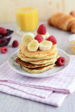 Breakfast cottage cheese pancakes with banana and coconut flakes Royalty Free Stock Photography