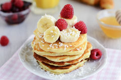 Breakfast cottage cheese pancakes with banana and coconut flakes Stock Photo