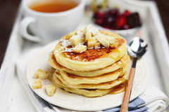 Breakfast cottage cheese pancakes with banana and coconut flakes Royalty Free Stock Image