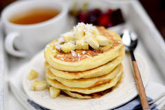 Breakfast cottage cheese pancakes with banana and coconut flakes Royalty Free Stock Images