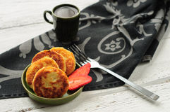Breakfast with cottage cheese pancakes, strawberry jam and coffe Royalty Free Stock Images