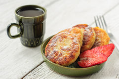 Breakfast with cottage cheese pancakes, strawberry jam and coffe Royalty Free Stock Photo