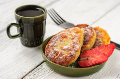 Breakfast with cottage cheese pancakes, strawberry jam and coffe Stock Images