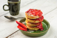 Breakfast with cottage cheese pancakes, strawberry jam and coffe Royalty Free Stock Photos