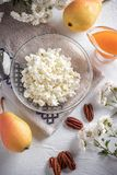 Breakfast of cottage cheese, pear and jam royalty free stock images