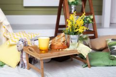 Breakfast on the cozy veranda. Homemade lemonade on the porch on a hot day. Summer country yard with pillows, mimosa flowers and l. Emonade. beautiful summer royalty free stock images