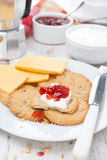 Breakfast with crackers, cheese, cream and berry jam, close-up Royalty Free Stock Image