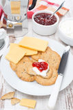 Breakfast with crackers, cheese, cream and berry jam Royalty Free Stock Photos