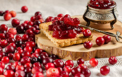 Breakfast with cranberries, jam and biscuits. Stock Photos