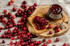 Breakfast with cranberries, jam and biscuits. Royalty Free Stock Images