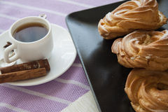 Breakfast with cream puffs Royalty Free Stock Photography