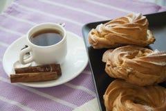 Breakfast with cream puffs Stock Photo
