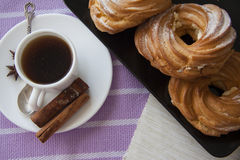 Breakfast with cream puffs Stock Photography
