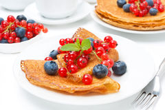 Breakfast with crepes and fresh berries Royalty Free Stock Image