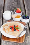 Breakfast - crepes with fresh berries and honey stock images